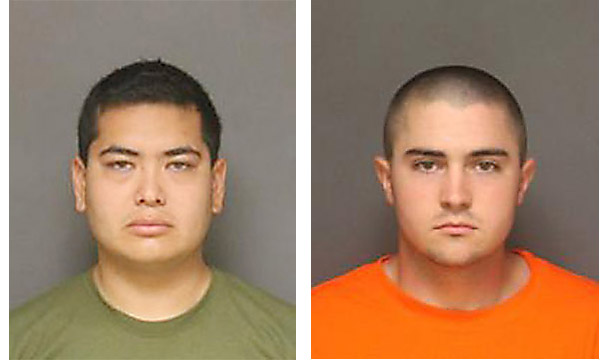 Frank Felix, 25, Sun Valley and Josh Acosta, 21, Fort Irwin, and have been placed under arrest and are in the process of being booked at the Fullerton City Jail in connection with the three murders that occurred yesterday morning in Fullerton. in Fullerton on Sunday, September 25, 2016. (Photo by Courtesy of Fullerton PDOrange County Register/SCNG)