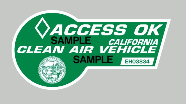 A green high-occupany vehicle sticker issued by the California DMV allows solo drivers of certain plug-in hybrids such as the Toyota Prius and Chevy Volt to use the carpool lane. (Courtesy California DMV)