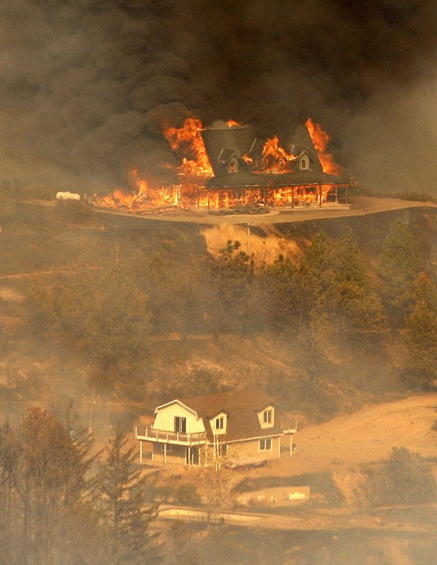A structure burns at the Loma Fire burning off Loma Prieta Rd and Loma Chiquita Rd in Santa Clara County on Monday, Sept. 26, 2016. (Vern Fisher - Monterey Herald)