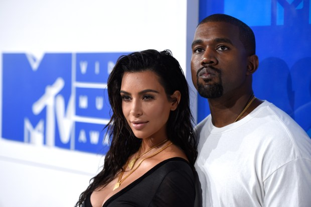 FILE - In this Aug. 28, 2016 file photo, Kim Kardashian West, left, and Kanye West arrive at the MTV Video Music Awards in New York. The couple rarely make a move that isn't heavily documented on social media, either by themselves, their fans or all those people who love to hate them. The two married on May 24, 2014, in a lavish ceremony in Florence, Italy. (Photo by Evan Agostini/Invision/AP, File)