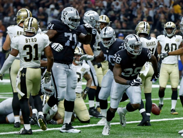Oakland Raiders running back Latavius Murray (28) celebrates his touchdown in the first half of an NFL football game against the New Orleans Saints in New Orleans, Sunday, Sept. 11, 2016. (AP Photo/Bill Feig)