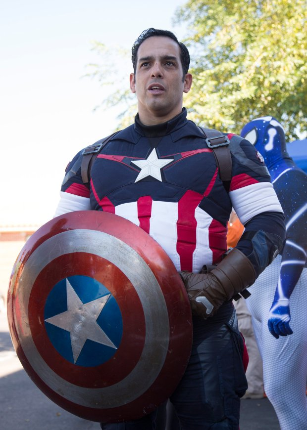 Gus Matos, of Tempe, dressed as Captain America, gives his thoughts on the election while attending a high school fair in Phoenix, Ariz., Saturday, Sept. 17, 2016. (Patrick Tehan/Bay Area News Group)