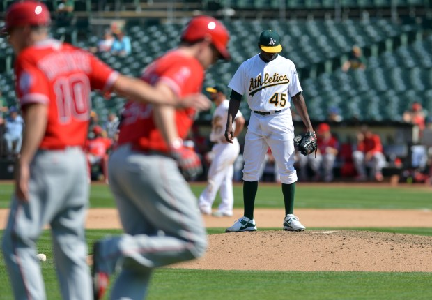 Oakland Athletics starting pitcher Jharel Cotton (45) prepares to go back to work after surrendering a solo home run to C.J. Cron (24) in the seventh inning during a game against the Los Angeles Angels at the Oakland Coliseum in Oakland, Calif., on Wednesday, Sept. 7, 2016. In his major league debut, Cotton gave up two hits and one run in the Athletics' 4-1 win over the Angels. (Kristopher Skinner/Bay Area News Group)