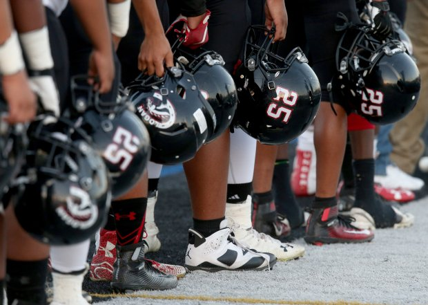 James Logan football players wear the #25 on their helmets in honor of Izaiah Mease during a football game in Concord, Calif., on Friday, Sept. 16, 2016. Students senior and linebacker Izaiah Mease and junior Joe Ioramo were both killed in a car crash on Interstate 880 in Hayward. (Anda Chu/Bay Area News Group)