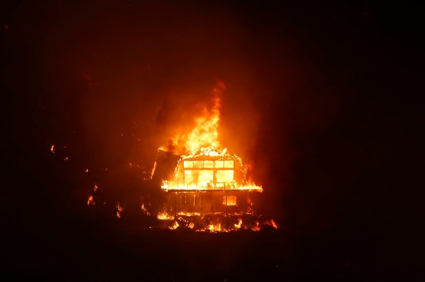A structure burns in the Santa Cruz mountains in on Monday, Sept. 26, 2016. (Nhat V. Meyer/Bay Area News Group)
