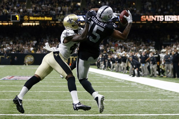 Michael Crabtree #15 of the Oakland Raiders catches a pass over Delvin Breaux #40 of the New Orleans Saints completing a two-point conversion to take the lead late in the second half of a game at Mercedes-Benz Superdome on September 11, 2016 in New Orleans, Louisiana. (Photo by Jonathan Bachman/Getty Images)