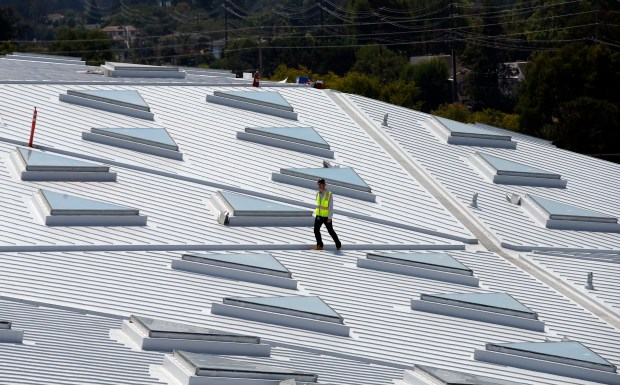 Jack Dahlgren, Nvidia's project manager, walks among the new building's 246 triangular skylights in Santa Clara, Calif., Tuesday, Aug. 23, 2016. (Karl Mondon/Bay Area News Group)