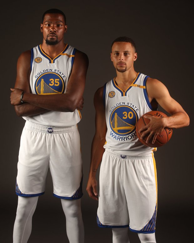 80844b32fca Golden State Warriors players Kevin Durant (35) and Stephen Curry (30) are