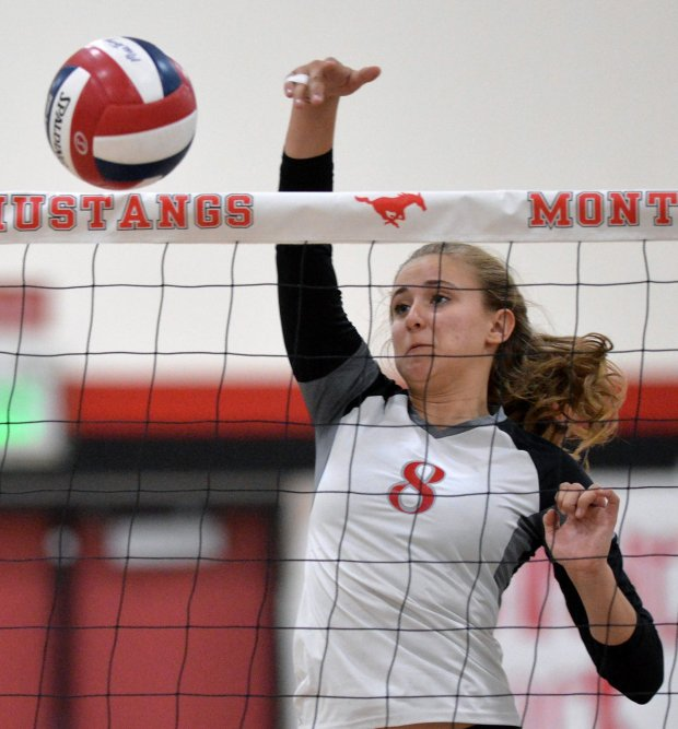 Monte Vista High's Maddie Dailey (8) scores a point during their volleyball match against San Ramon Valley High in Danville, Calif., on Tuesday, Sept. 20, 2016. (Doug Duran/Bay Area News Group)