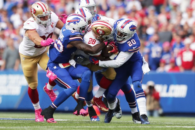 Carlos Hyde #28 of the San Francisco 49ers is hit by Aaron Williams #23 of the Buffalo Bills and Corey Graham #20 of the Buffalo Bills during the first half at New Era Field on October 16, 2016 in Buffalo, New York. (Photo by Brett Carlsen/Getty Images)