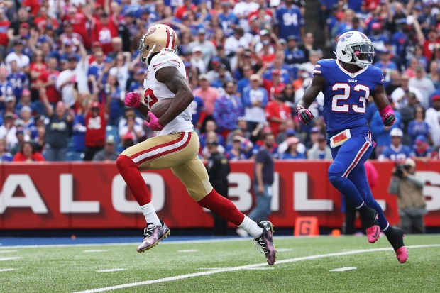 BUFFALO, NY - OCTOBER 16: Torrey Smith #82 of the San Francisco 49ers breaks free of Aaron Williams #23 of the Buffalo Bills for a touchdown during the first half at New Era Field on October 16, 2016 in Buffalo, New York. (Photo by Tom Szczerbowski/Getty Images)