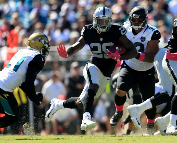 Latavius Murray #28 of the Oakland Raiders runs for yardage against the Jacksonville Jaguars during the game at EverBank Field on October 23, 2016 in Jacksonville, Florida.  (Photo by Rob Foldy/Getty Images)