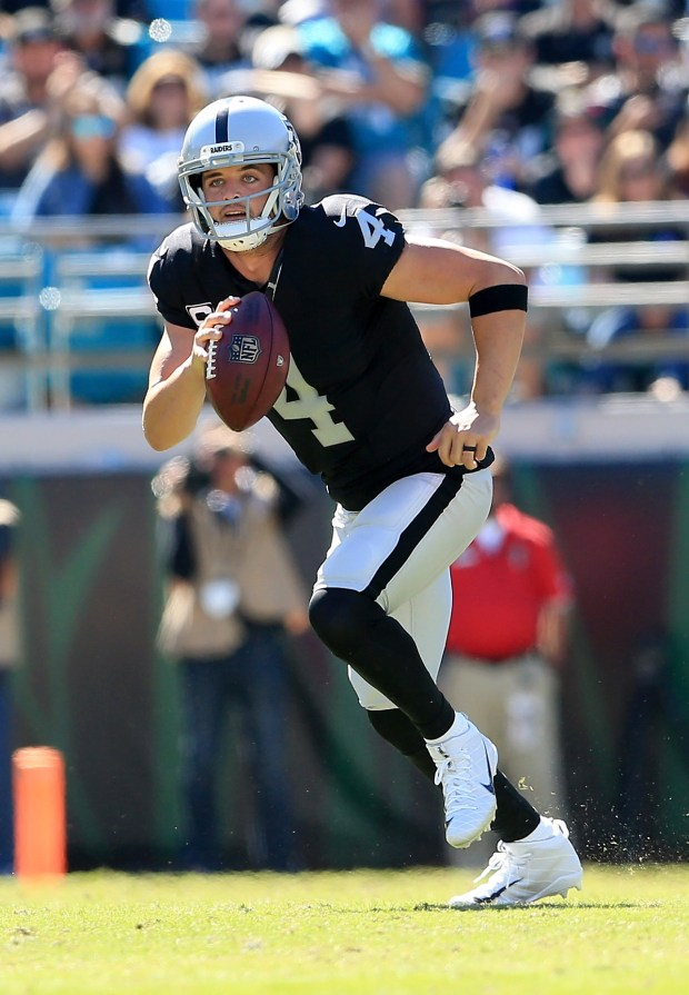 Derek Carr #4 of the Oakland Raiders runs for yardage against the Jacksonville Jaguars during the game at EverBank Field on October 23, 2016 in Jacksonville, Florida. (Photo by Rob Foldy/Getty Images)