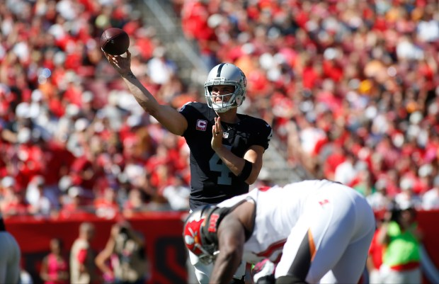 Quarterback Derek Carr #4 of the Oakland Raiders throws to an open receiver during the first quarter of an NFL game against the Tampa Bay Buccaneers on October 30, 2016 at Raymond James Stadium in Tampa, Florida. (Photo by Brian Blanco/Getty Images)