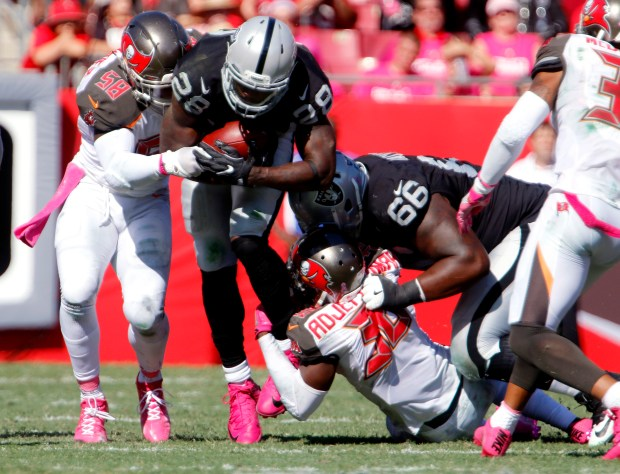 Running back Latavius Murray #28 of the Oakland Raiders is brought down by middle linebacker Kwon Alexander #58 of the Tampa Bay Buccaneers during the third quarter at Raymond James Stadium on October 30, 2016 in Tampa, Florida. (Photo by Joseph Garnett Jr. /Getty Images)
