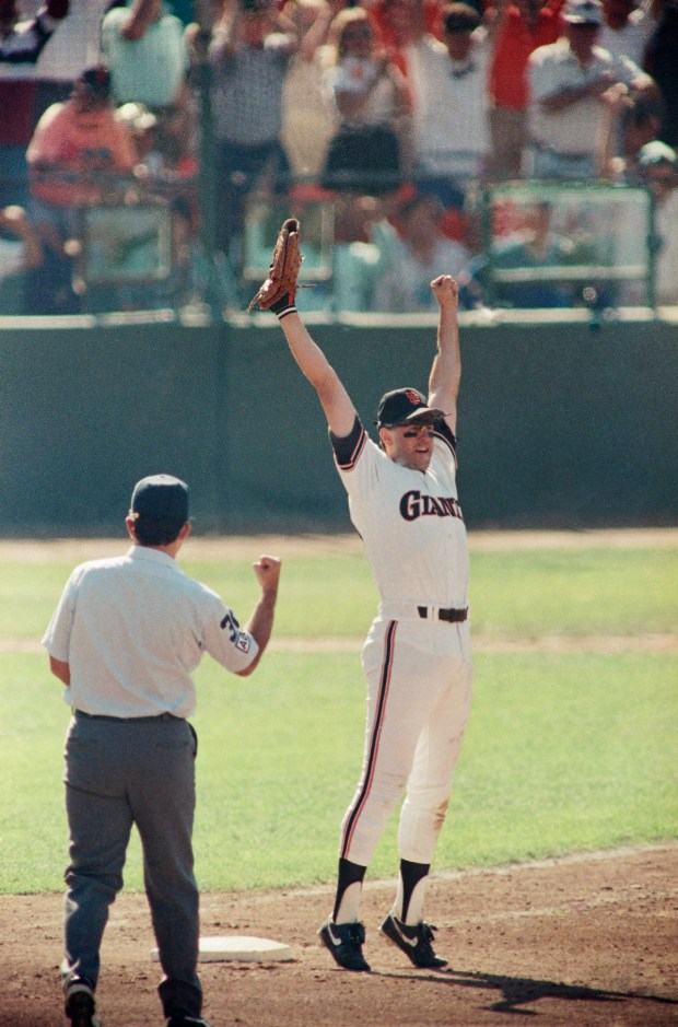 San Francisco Giants Will Clark leaps in joy as first base umpire Randy Marsh signals the final out of the National League Playoffs, Monday, Oct. 9, 1989, San Francisco, Calif. The Giants beat the Cubs 3-2 to capture the series in five games and advance to the World Series. (AP Photo/John Gaps)