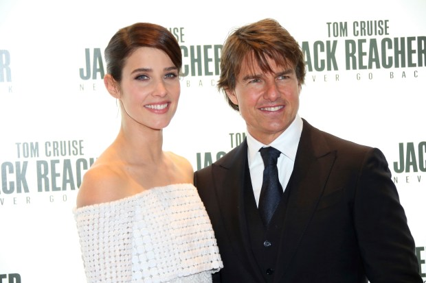 Actors Cobie Smulders and Tom Cruise pose for photographerss upon arrival at the premiere of the film 'Jack Reacher: Never Go Back', in London, Thursday, Oct. 20, 2016. (Photo by Joel Ryan/Invision/AP)