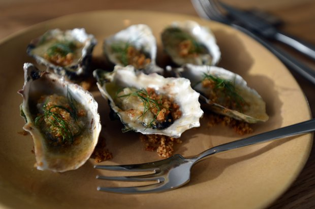 The roasted oysters with fennel butter awaits a diner in the Limewood Bar & Restaurant at the Claremont Hotel & Spa in Berkeley, Calif., on Monday, Oct. 17, 2016. (Kristopher Skinner/Bay Area News Group)
