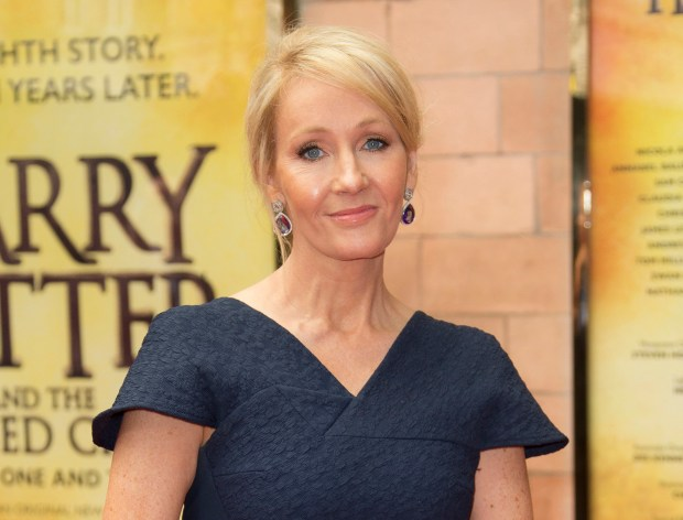 "FILE - In this July 30, 2016, file photo, writer J.K. Rowling poses for photographers upon arrival at gala performance of ""Harry Potter and the Cursed Child,"" in central London. Rowling clarified on Sept. 22, 2016, that slain Ohio gorilla, Harambe, is not a part of her fictional universe. The comment on Twitter came after Rowling retweeted a fake photo of Harambe as a result on the Patronus page of her Pottermore website. (Photo by Joel Ryan/Invision/AP, File)"