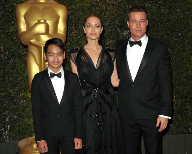 In this Nov. 16, 2013 file photo, Maddox Jolie-Pitt, from left, Angelina Jolie and Brad Pitt attend the 2013 Governors Awards in Los Angeles. (Photo by John Shearer/Invision/AP, File)