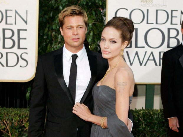 FILE - In this Jan. 15, 2007 file photo, Brad Pitt, and actress Angelina Jolie arrive for the 64th Annual Golden Globe Awards in Beverly Hills, Calif. The couple have reached a temporary agreement that will allow the actor to visit with his six children, sources familiar with the arrangement told The Associated Press on Friday, Sept. 30, 2016. Jolie Pitt filed for divorce last week. (AP Photo/Mark J. Terrill, File)