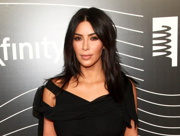 FILE - In this May 16, 2016 file photo, Kim Kardashian West attends the 20th Annual Webby Awards in New York. After an encounter with armed robbers in Paris on Monday, Oct. 3, Kardashian West went social media silent. On Instagram, where she has more than 84 million followers, the most recent posts were from the day before, having spent fashion week happily sharing snippets of video and photos, including one showing her massive diamond ring. (Photo by Andy Kropa/Invision/AP, File)