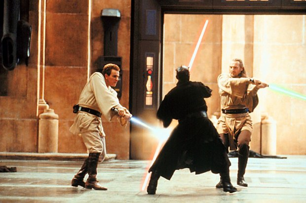 "jedi qui-gon jinn (liam nelson) and his apprentice obi-wan kenobi (ewan mcgregor, right) battle sith lord darth maul (ray park) in ""the phantom menace"""