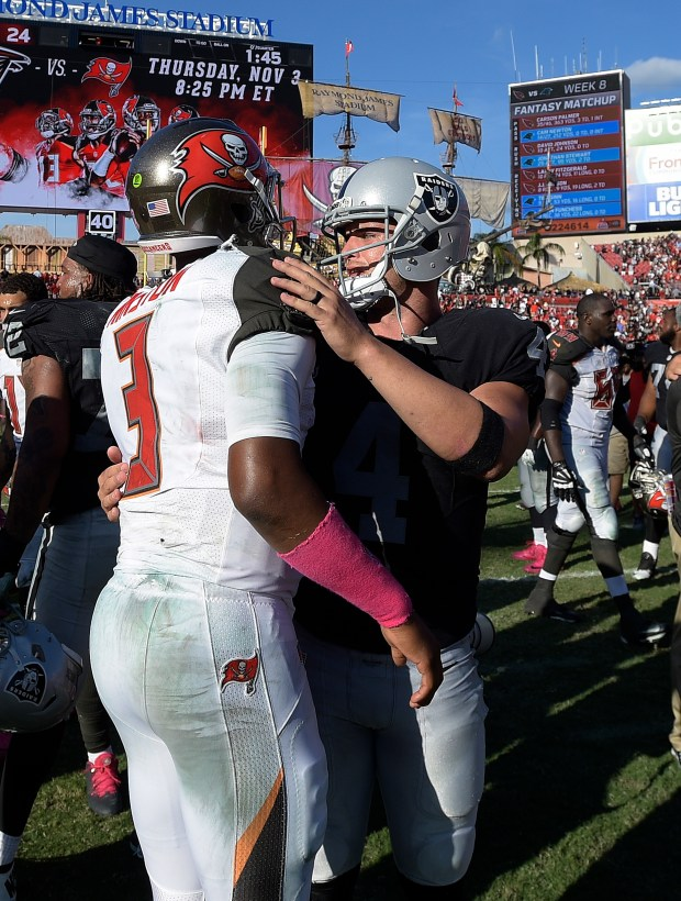 Tampa Bay Buccaneers quarterback Jameis Winston (3) congratulates Oakland Raiders quarterback Derek Carr (4) after the Raiders defeated the Tampa Bay Buccaneers 30-24 in overtime during an NFL football game Sunday, Oct. 30, 2016, in Tampa, Fla. (AP Photo/Phelan M. Ebenhack)