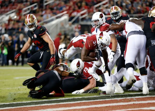 Arizona Cardinals' David Johnson (31) dives in to score touchdown against the San Francisco 49ers in the second half in their NFL game at Levi's Stadium in Santa Clara, Calif., on Thursday, Oct. 6, 2016. (Josie Lepe/Bay Area News Group)