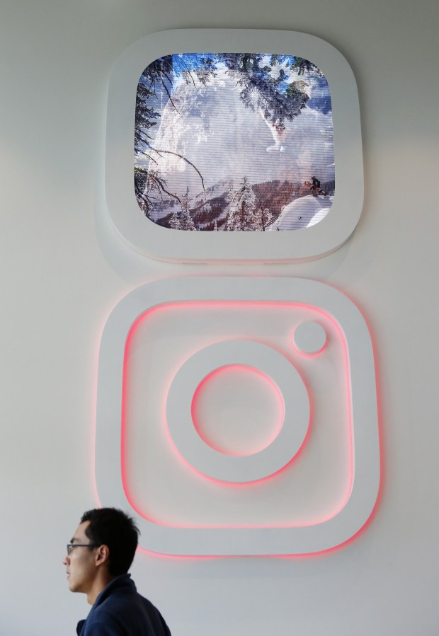 The Instagram logo and streaming images decorate the Instagram lobby in Menlo Park, Calif., on Tuesday, Oct. 4, 2016. As Instagram continues to expand, some areas in their new headquarters reflects some of their unique workplace culture. (Gary Reyes/Bay Area News Group)