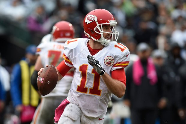 Kansas City Chiefs quarterback Alex Smith (11) looks to pass against the Oakland Raiders in the third quarter of their NFL game at the Coliseum in Oakland, Calif., on Sunday, Oct. 16, 2016. Kansas City defeated Oakland 26-10. (Jose Carlos Fajardo/Bay Area News Group)