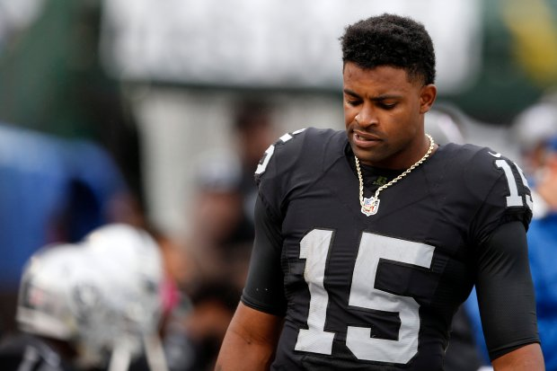 Oakland Raiders' Michael Crabtree (15) looks down on the sideline as the Raiders lose to Kansas City Chiefs in the fourth quarter of their NFL game at Oakland Coliseum in Oakland, Calif, on Sunday, Oct. 16, 2016. (Ray Chavez/Bay Area News Group)
