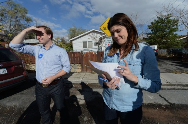 Hillary Clinton supporters Brigitte and Lucas Lyons, of Oakland, work on canvasing a neighborhood for the democratic party in Reno, Nevada on Saturday, Oct. 29, 2016. Hundreds of Bay Area volunteers are driving to Nevada, a battleground state, to work for their candidates. (Dan Honda/Bay Area News Group)