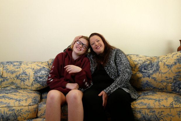 Monica Halloran, right, poses for a picture with her daughter Myra, 15, at their home in San Carlos, Calif., on Sunday, Oct. 30, 2016. Monica Halloran was offered a full-time job at her recent internship, she credits her success through a 2-year Self-Sufficiency program offered by HIP Housing. (Nhat V. Meyer/Bay Area News Group)