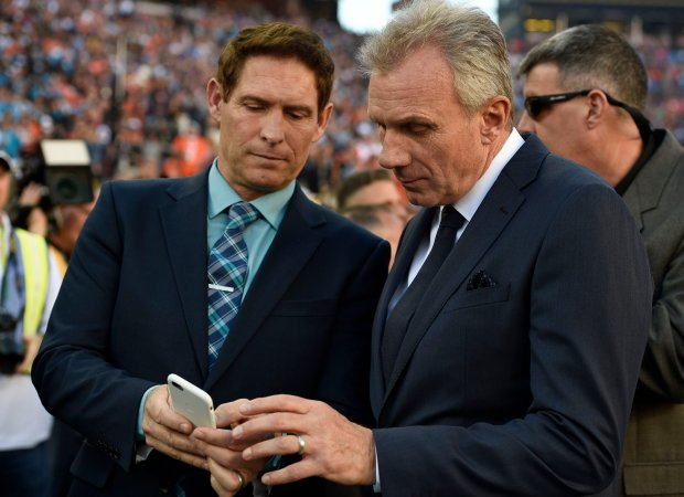 Former San Francisco 49ers quarterbacks Steve Young, left, and Joe Montana mingle on the field before Super Bowl 50 between the Denver Broncos and Carolina Panthers at Levi's Stadium in Santa Clara, Calif., on Sunday, Feb. 7, 2016. (Jose Carlos Fajardo/Bay Area News Group)