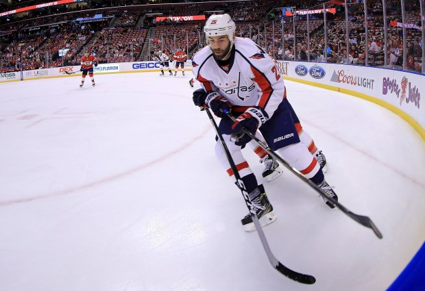SUNRISE, FL - OCTOBER 20: Daniel Winnik #26 of the Washington Capitals carries the puck during a game against the Florida Panthers at BB&T Center on October 20, 2016 in Sunrise, Florida. (Photo by Mike Ehrmann/Getty Images)