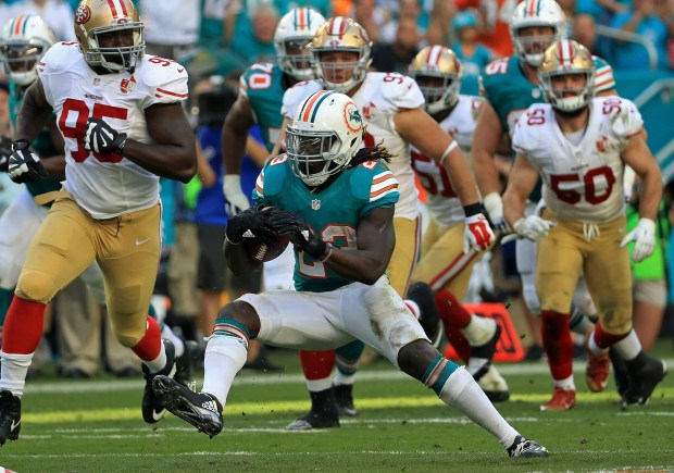 MIAMI GARDENS, FL - NOVEMBER 27:  Jay Ajayi #23 of the Miami Dolphins rushes during a game against the San Francisco 49ers on November 27, 2016 in Miami Gardens, Florida.  (Photo by Mike Ehrmann/Getty Images)