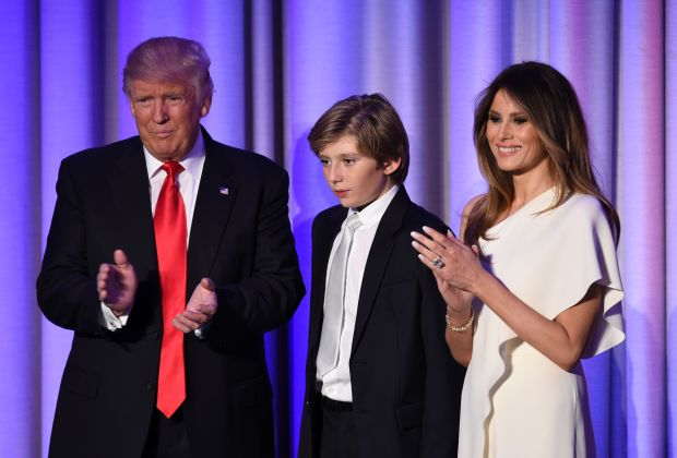 (FILES) This file photo taken on November 8, 2016 shows US President-elect Donald Trump arriving with his son Barron and wife Melania at the New York Hilton Midtown in New York on November 8, 2016. Donald Trump's wife Melania and young son Barron will probably stay in New York when the president-elect moves into the White House, the transition team suggested November 20, 2016. The parents are wary of pulling their son out of school now, team communications director Jason Miller told reporters. / AFP PHOTO / SAUL LOEBSAUL LOEB/AFP/Getty Images
