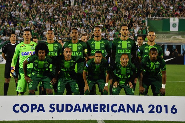 November 24, 2016:  Brazil's Chapecoense players pose for pictures during their 2016 Copa Sudamericana semifinal second leg football match against Argentina's San Lorenzo. (Nelson Almeida, AFP Getty)