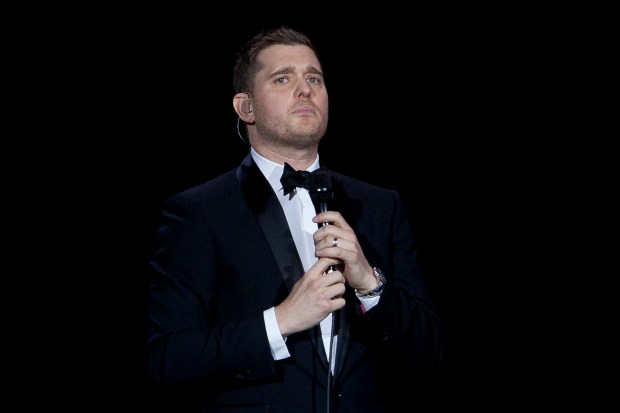 FILE - In this Jan. 31, 2014, file photo, Canadian singer Michael Buble performs during his concert at Palacio de los Deportes in Madrid, Spain. Buble announced on Nov. 4, 2016, that his 3-year-old son has been diagnosed with cancer and is undergoing treatment in the U.S. (AP Photo/Abraham Caro Marin, File)