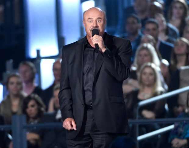 Dr. Phil McGraw speaks on stage at the 50th annual Academy of Country Music Awards at AT&T Stadium on Sunday, April 19, 2015, in Arlington, Texas. (Photo by Chris Pizzello/Invision/AP)