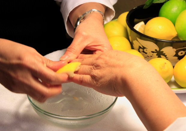 "Lan-Ahn Truong puts lemon on the cuticles of Matthew Tejada, director of Environmental Justice at the Environmental Protection Agency, as she gives him a manicure after a press conference held at Leann's Nails in Alameda, Calif., on Wednesday, Nov. 30, 2016. Using lemon as a cuticle softener is one of the ""Healthy Nail Salon"" standards. The EPA announced the award of an Environmental Justice grant to Asian Health Services in partnership with the California Healthy Nail Salon Collaborative to help nail salon owners achieve ""healthy nail salon"" standards to protect their employees and customers. Truong's salon became certified as a ""Healthy Nail Salon"" in 2013.(Laura A. Oda/Bay Area News Group)"