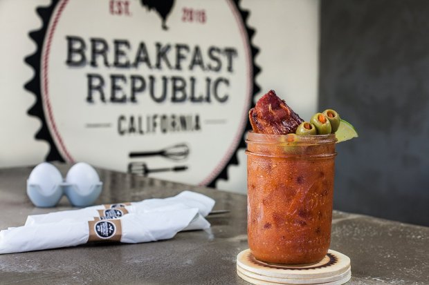 The new Breakfast Republic outpost at San Diego's Liberty Station serves chorizo omelets, churro pancakes, breakfast sandwiches, beer flights and brunch cocktails, such as this Jurassic Pork Bloody Mary. (Breakfast Republic)