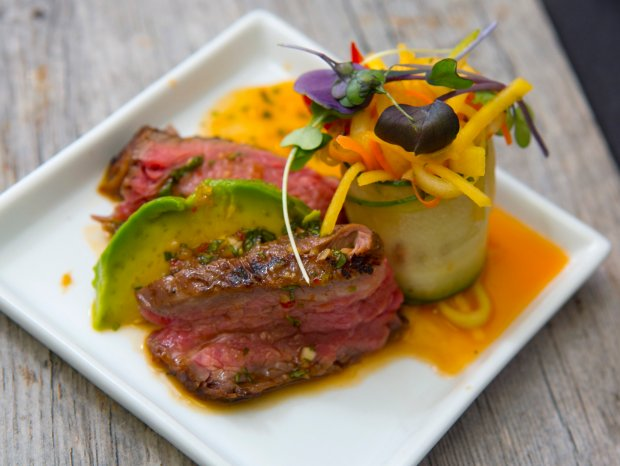 "Grilled Flank Steak (grilled flank steak with a cucumber, avocado, carrot, mango salad with crispy rice noodles and chili glaze), part of a festive party spread of mini foods, from salad and appetizer to protein/entree and dessert created at Handheld Catering in Santa Clara, Calif., Tuesday, Nov. 15, 2016. Chef/owner, Ryan McTighe, suggests an elegant ""minis"" cocktail holiday party for grownups. (Patrick Tehan/Bay Area News Group)"