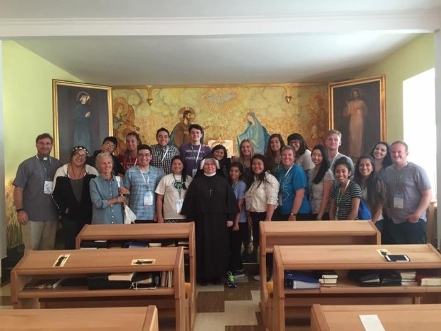 COURTESY BRADLEY SMITH POLAND: Bradley Smith, fourth from the left in the front row, a junior at Palo Alto High, went to World Youth Day in Warsaw this summer with 22 other teens and young adults from Los Altos' St. William and St. Nicholas churches.