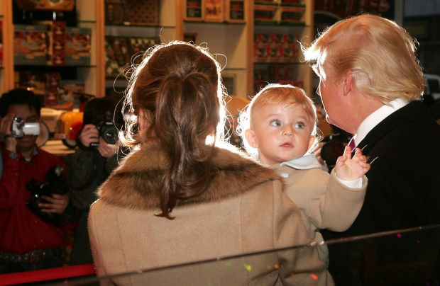NEW YORK - MARCH 13: Donald Trump, Barron Trump and Melania Trump attend the 16th Annual Bunny Hop at FAO Schwartz to benefit the Memorial Sloan-Kettering Cancer Center March 13, 2007 in New York City. (Photo by Peter Kramer/Getty Images For MSKCC)