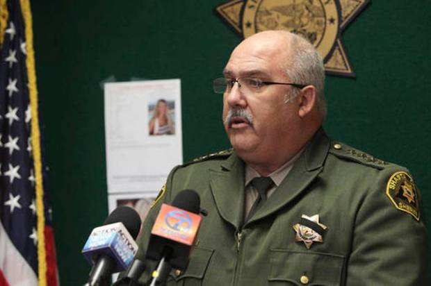In this Thursday, Nov. 24, 2016 photo, Shasta County, Calif., Sheriff Tom Bosenko addresses the media during a press conference regarding a missing woman who was found, in Yolo County, Calif. Authorities were searching Thursday for two women suspected in the abduction of Sherri Papini a California mother who turned up safe near an interstate three weeks after she disappeared. (The Record Searchlight via AP Andreas Fuhrmann)