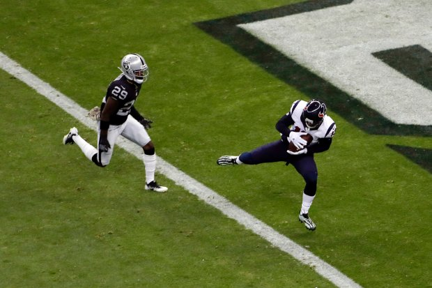 Houston Texans wide receiver Braxton Miller, right, scores a touchdown over Oakland Raiders cornerback David Amerson (29) during the first half of an NFL football game Monday, Nov. 21, 2016, in Mexico City. (AP Photo/Dario Lopez-Mills)
