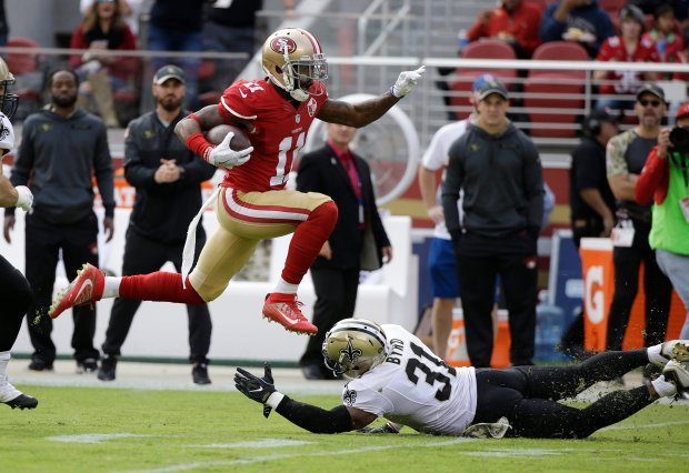 San Francisco 49ers wide receiver Quinton Patton runs with the ball over New Orleans Saints free safety Jairus Byrd during the first half of an NFL football game, Sunday, Nov. 6, 2016, in Santa Clara, Calif. (AP Photo/Tony Avelar)