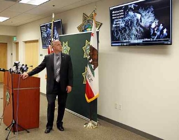 Undersheriff Jeremy Verinsky describes the body camera video of the shooting of Luke Smith during a press conference Monday. (Dan Coyro -- Santa Cruz Sentinel)
